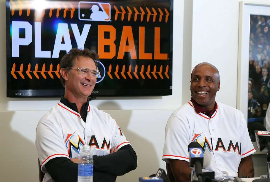 Clean-shaven Marlins include manager Don Mattingly (left) and hitting coach Barry Bonds. Photo: David Santiago, McClatchy-Tribune News Service