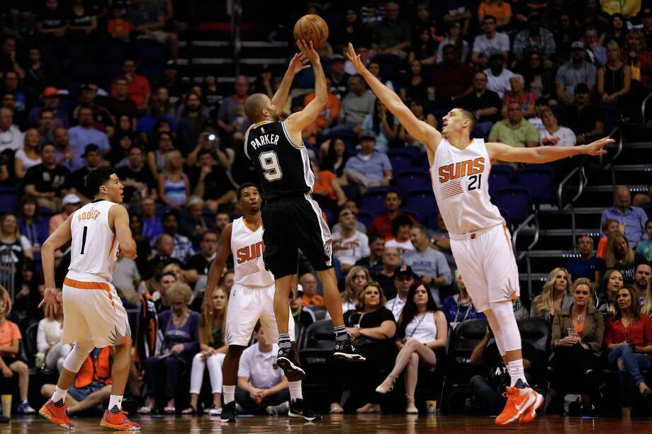 PHOENIX, AZ - FEBRUARY 21:  Tony Parker #9 of the San Antonio Spurs puts up a shot over Alex Len #21 of the Phoenix Suns during the first half of the NBA game at Talking Stick Resort Arena on February 21, 2016 in Phoenix, Arizona.  NOTE TO USER: User expressly acknowledges and agrees that, by downloading and or using this photograph, User is consenting to the terms and conditions of the Getty Images License Agreement. Photo: Christian Petersen, Getty Images / 2016 Getty Images
