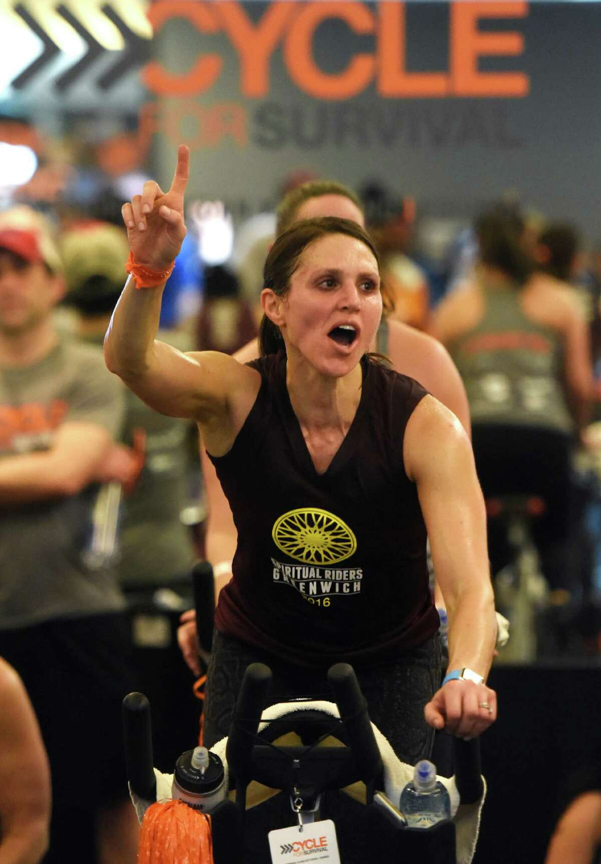 Lachmont, N.Y. resident Alexis Katz, of team Spiritual Riders, rides during the Cycle for Survival indoor cycling fundraiser at Equinox in Greenwich, Conn. Sunday, Feb. 21, 2016. Cycle for Survival, owned and operated by Memorial Sloan Kettering, is a fundraiser with the goal to beat rare cancers by raising money through a series of indoor cycling events across the country. 2016 marks the tenth year of rides and the event has raised over $90 million since 2007. More than 800 riders participated at the event in Greenwich Sunday and the Spiritual Riders team led the way raising more than $140,000 alone.