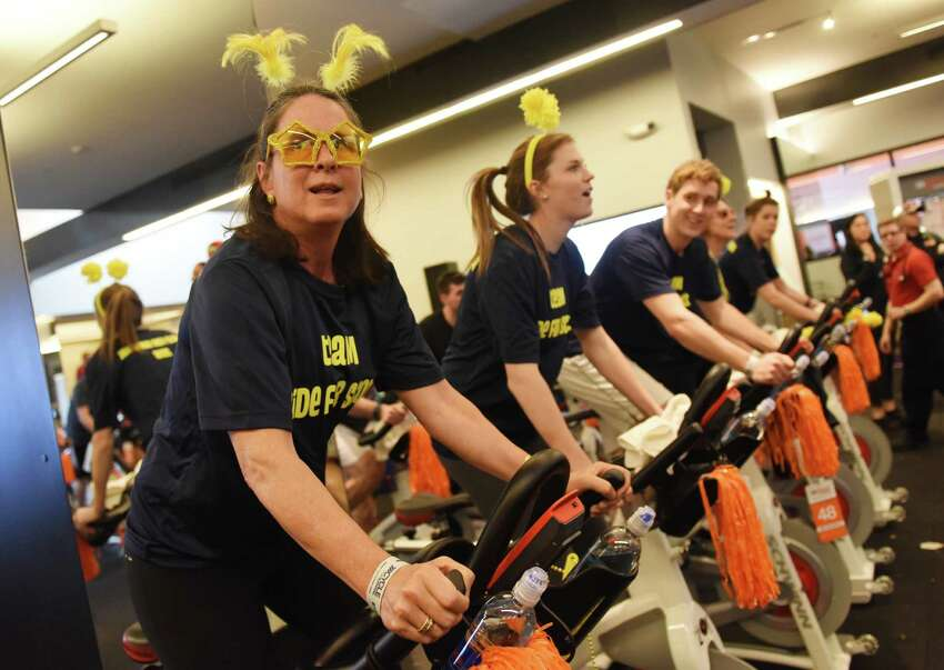 Darien resident Gigi Garnett, of team Ride for Scott, rides during the Cycle for Survival indoor cycling fundraiser at Equinox in Greenwich, Conn. Sunday, Feb. 21, 2016. Cycle for Survival, owned and operated by Memorial Sloan Kettering, is a fundraiser with the goal to beat rare cancers by raising money through a series of indoor cycling events across the country. 2016 marks the tenth year of rides and the event has raised over $90 million since 2007. More than 800 riders participated at the event in Greenwich Sunday and the Spiritual Riders team led the way raising more than $140,000 alone.
