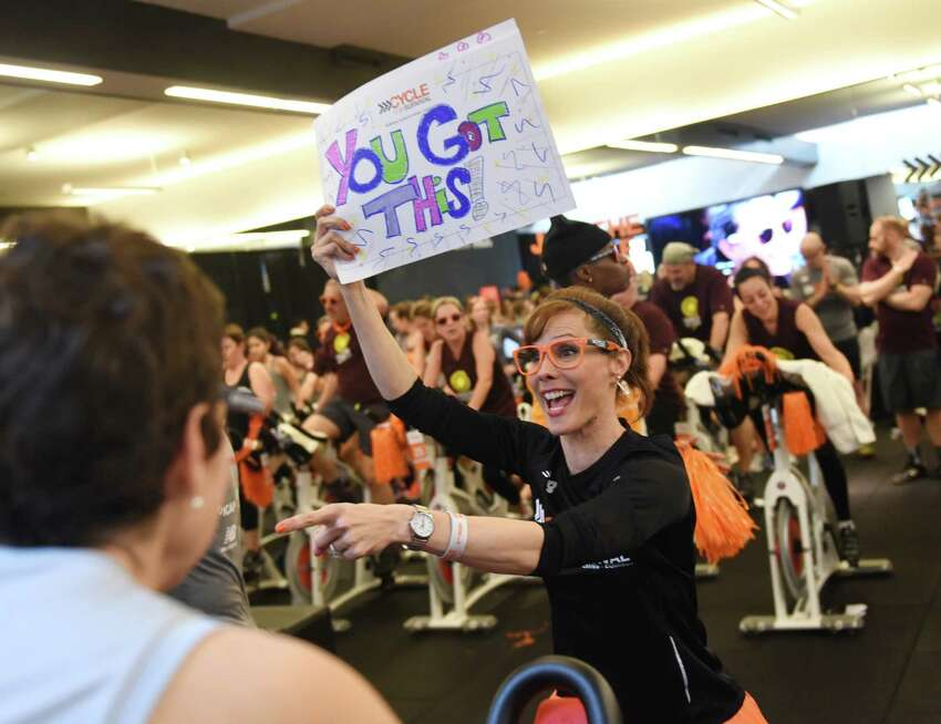 Event emcee Tracey Wilson pumps up the riders during the Cycle for Survival indoor cycling fundraiser at Equinox in Greenwich, Conn. Sunday, Feb. 21, 2016. Cycle for Survival, owned and operated by Memorial Sloan Kettering, is a fundraiser with the goal to beat rare cancers by raising money through a series of indoor cycling events across the country. 2016 marks the tenth year of rides and the event has raised over $90 million since 2007. More than 800 riders participated at the event in Greenwich Sunday and the Spiritual Riders team led the way raising more than $140,000 alone.