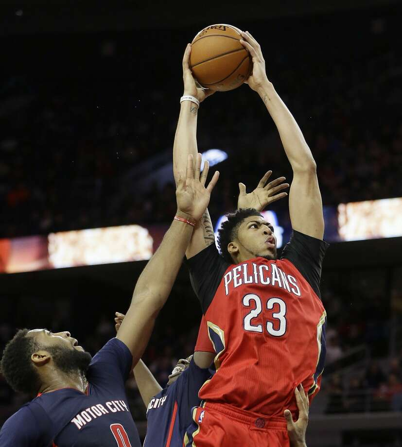 Pelicans forward Anthony Davis moves toward the basket in Detroit. Davis finished with 59 points and 20 rebounds. Photo: Carlos Osorio, Associated Press