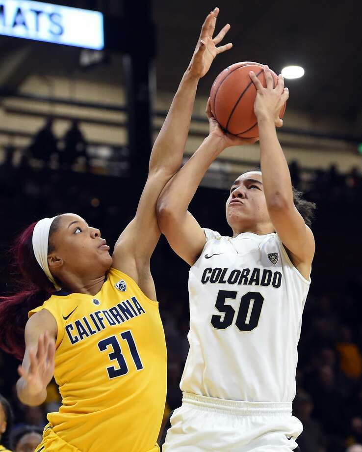 Cal's Kristine Anigwe, who had 30 points, guards Colorado's Jamee Swan during the Bears' loss at Boulder, Colo. Photo: Cliff Grassmick, Associated Press