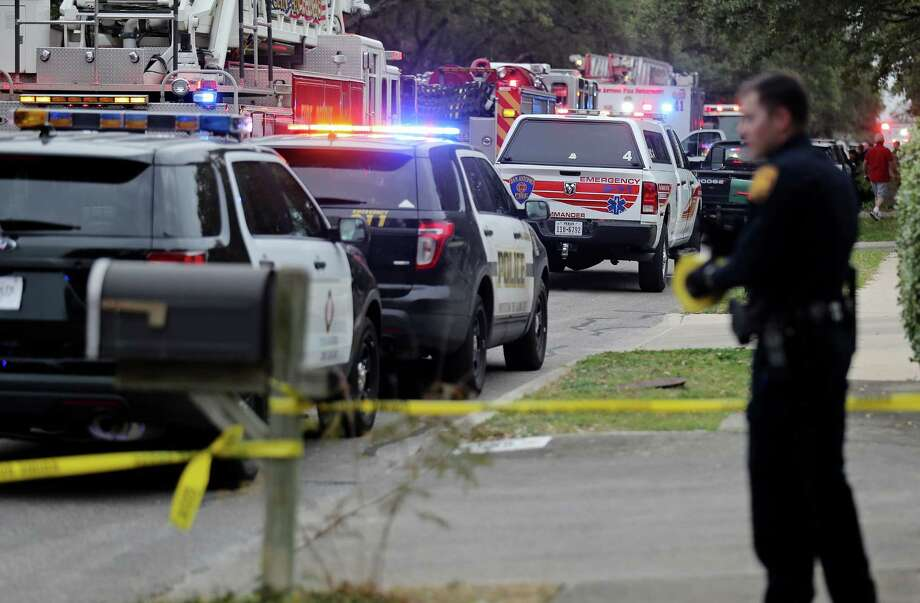 Emergency personnel at the scene of a fire and possible explosion Sunday Feb. 21, 2016 in the 8400 block of Pendragon Street. One man is reported dead at the scene. Photo: Edward A. Ornelas, San Antonio Express-News / © 2016 San Antonio Express-News