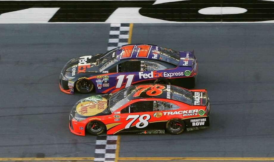 Denny Hamlin (11) beats out Martin Truex Jr. (78) at the finish line to win the NASCAR Daytona 500 auto race at Daytona International Speedway, Sunday, Feb. 21, 2016, in Daytona Beach, Fla. (AP Photo/Wilfredo Lee) ORG XMIT: DBR107 Photo: Wilfredo Lee / AP