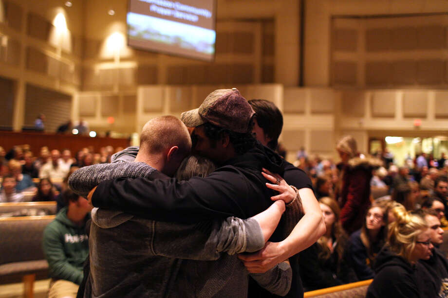 Members of the community pray before the start of the Kalamazoo Community Prayer Service at Centerpoint Church on in Kalamazoo, Mich., Sunday, Feb 21, 2016. A gunman who seemed to choose his victims at random opened fire Saturday outside an apartment complex, a car dealership and a restaurant in Michigan, killing six people in a rampage that lasted nearly seven hours, police said. (Andraya Croft/Detroit Free Press via AP) Photo: Andraya Croft, Associated Press / Detroit Free Press