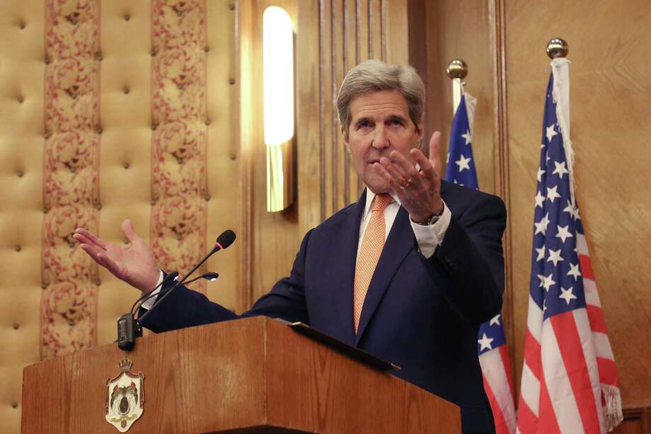 """Secretary of State John Kerry gestures during a joint press conference with his Jordanian counterpart Nasser Judeh (unseen) in Amman, Jordan, Sunday, Feb. 21, 2016. John Kerry said Sunday that a """"provisional agreement"""" has been reached on a Syrian cease-fire that could begin in the next few days, but he acknowledged that it's not finalized and all parties might not automatically comply.  (AP Photo/Raad Adayleh) Photo: Raad Adayleh, STR / Associated Press / AP"""