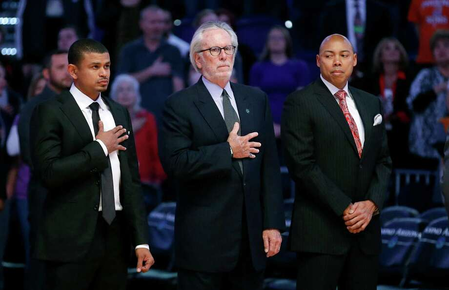 The Spurs offered Suns interim coach Earl Watson (left) an opening with Austin upon retiring and his brother's death. Photo: Ross D. Franklin / Associated Press / AP
