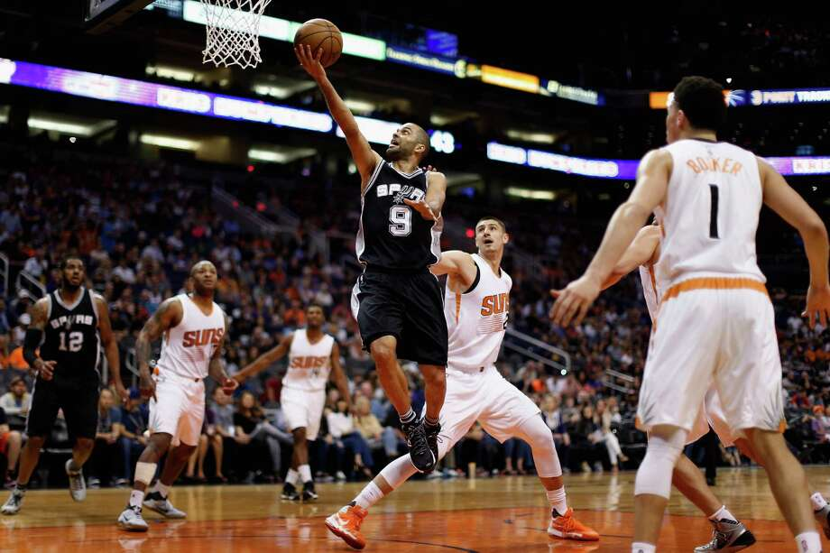 PHOENIX, AZ - FEBRUARY 21:  Tony Parker #9 of the San Antonio Spurs lays up a shot past Alex Len #21 of the Phoenix Suns during the second half of the NBA game at Talking Stick Resort Arena on February 21, 2016 in Phoenix, Arizona. The Spurs defeated the Suns 118-111.  NOTE TO USER: User expressly acknowledges and agrees that, by downloading and or using this photograph, User is consenting to the terms and conditions of the Getty Images License Agreement.  (Photo by Christian Petersen/Getty Images) Photo: Christian Petersen, Staff / Getty Images / 2016 Getty Images