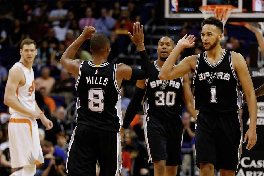 Kyle Anderson (1) of the San Antonio Spurs celebrates with Patty Mills (8) after scoring against the Phoenix Suns during the second half at Talking Stick Resort Arena on Feb. 21, 2016 in Phoenix. Photo: Christian Petersen /Getty Images / 2016 Getty Images