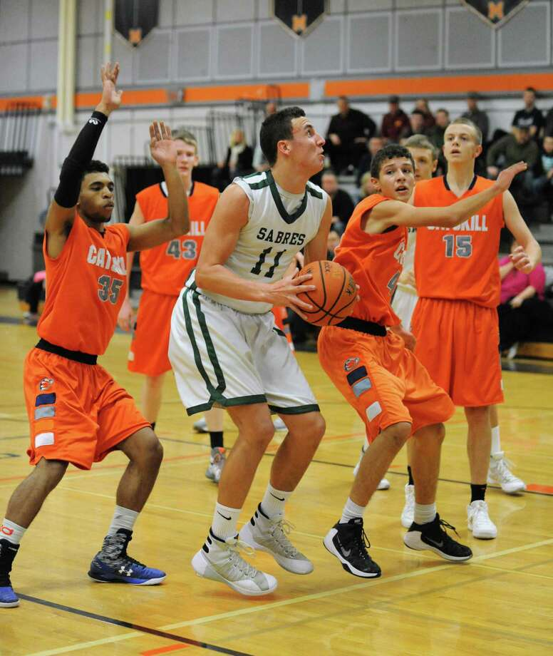 Shalmont's Zac O'Dell drives to the basket during their John F. Kirvin Basketball Tournament final game against Catskill at Mohonasen High School on Tuesday Dec. 29, 2015 in Rotterdam, N.Y.  (Michael P. Farrell/Times Union) Photo: Michael P. Farrell / 10034816A