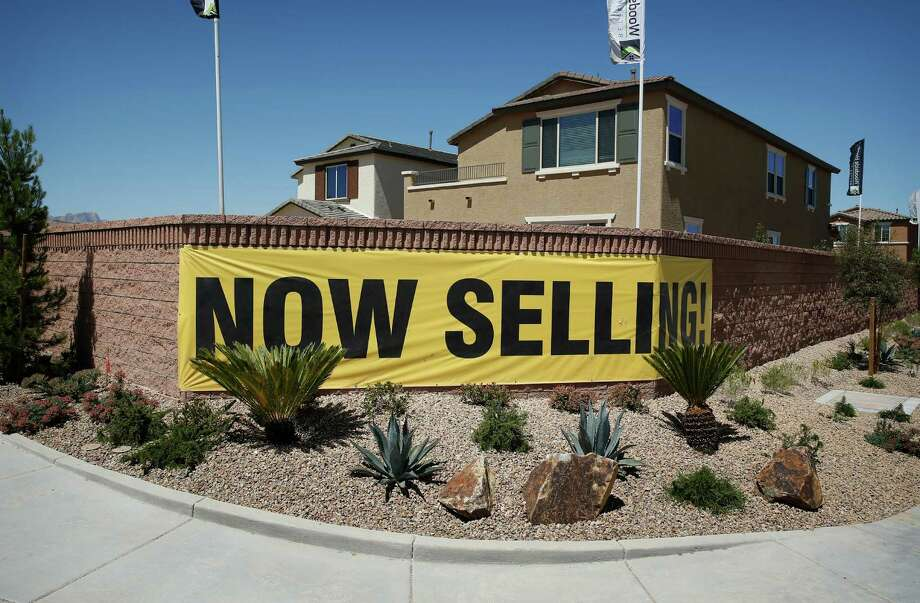 In this April 13, 2015 file photo, a sign advertises homes for sale in Las Vegas. Freddie Mac, the mortgage company, predicts a decline in the amount of single-home mortgages taken out. (AP Photo/John Locher, File) Photo: John Locher, STF / AP
