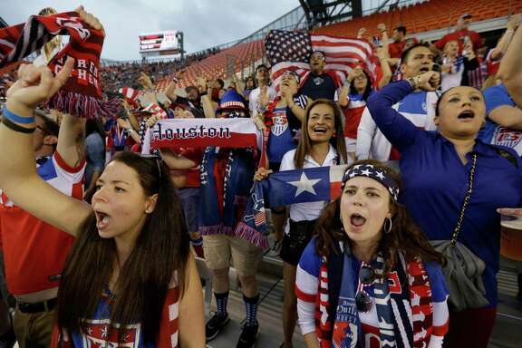 Amber Bingham, left, of Missouri City, and Lea Trapp, right, of Dallas cheer during the U.S. and Canada CONCACAF Olympic women's soccer qualifying championship final at BBVA Compass Stadium Sunday, Feb. 21, 2016, in Houston.
