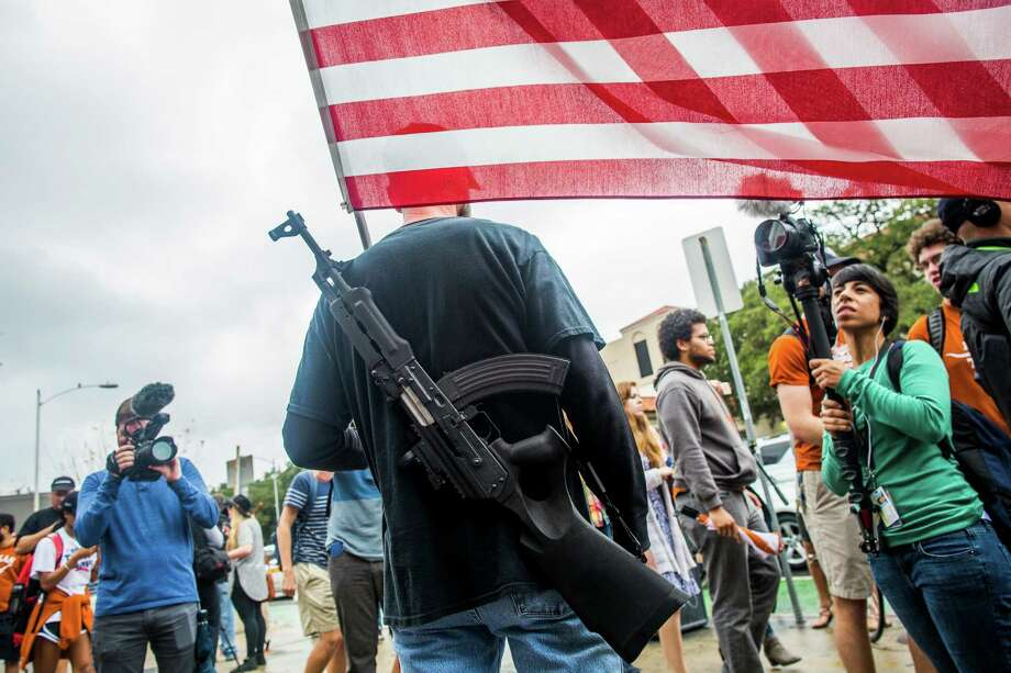 AUSTIN, TX - DECEMBER 12: Gun activists march close to The University of Texas campus December 12, 2015 in Austin, Texas. In addition to the event put on by DontComply.com, a gun activist organization, the group also held an open carry walk earlier in the day.  (Photo by Drew Anthony Smith/Getty Images) Photo: Drew Anthony Smith, Stringer / Getty Images / 2015 Getty Images