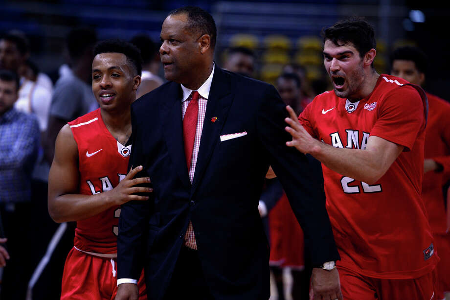 Lamar basketball players Nick Garth, left, and Preston Mattingly celebrate with their head coach, Tic Price, after beating McNeese State University 87-76 on Saturday afternoon.  Photo taken Saturday 2/20/16 Ryan Pelham/The Enterprise Photo: Ryan Pelham / ©2016 The Beaumont Enterprise/Ryan Pelham