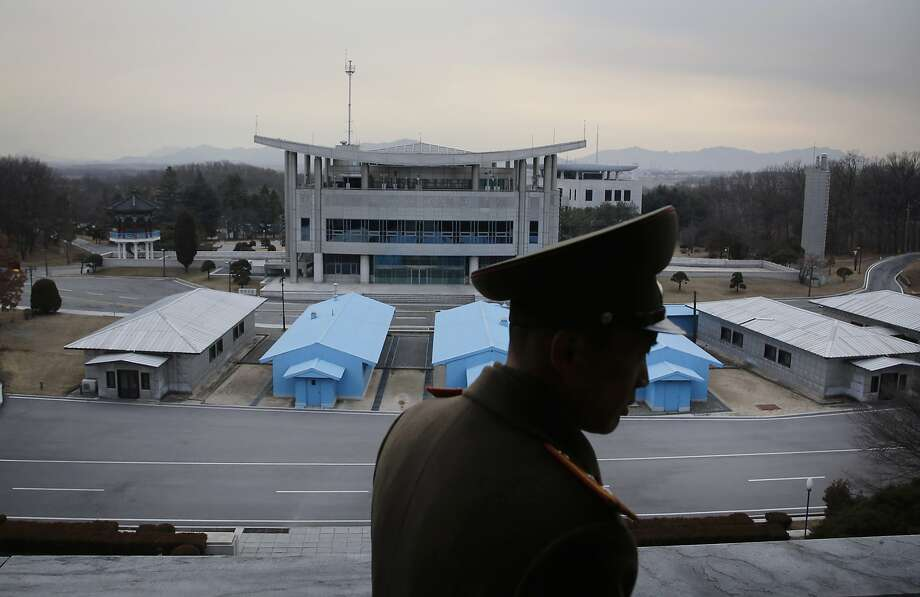 Army Lt. Col. Nam Dong Ho is silhouetted against the truce village of Panmunjom in North Korea. Photo: Wong Maye-E, Associated Press