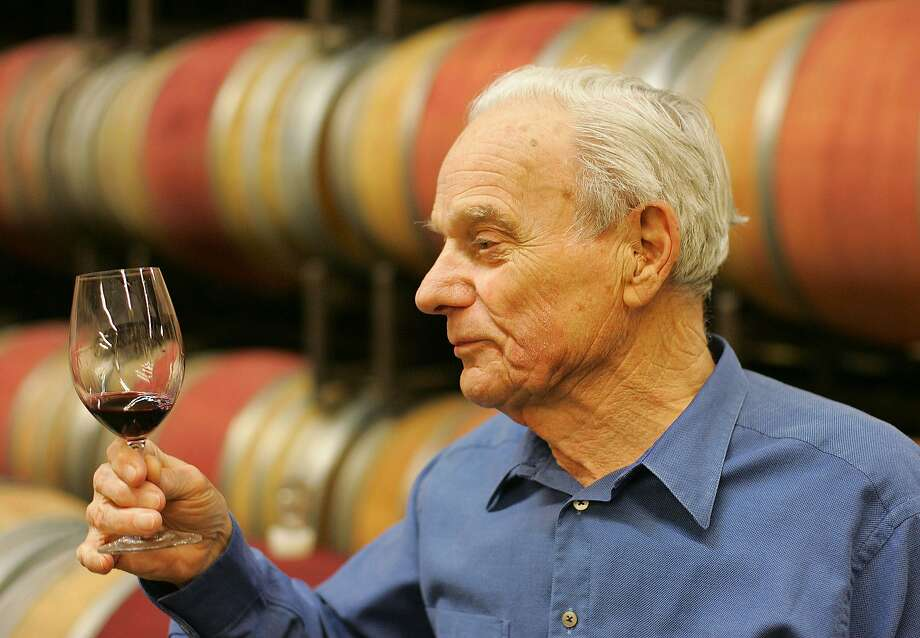 FILE - In this Thursday, May 19, 2005 file photo, Peter Mondavi samples a glass of Cabernet Sauvignon out of the barrel at the Charles Krug Winery in St. Helena, Calif. On Monday, Feb. 22, 2016, a winery board member said Mondavi, a wine country innovator who led his family's Charles Krug Winery through more than a half-century of change died Saturday, Feb. 20, 2016. He was 101. (AP Photo/Eric Risberg, File) Photo: Eric Risberg, Associated Press