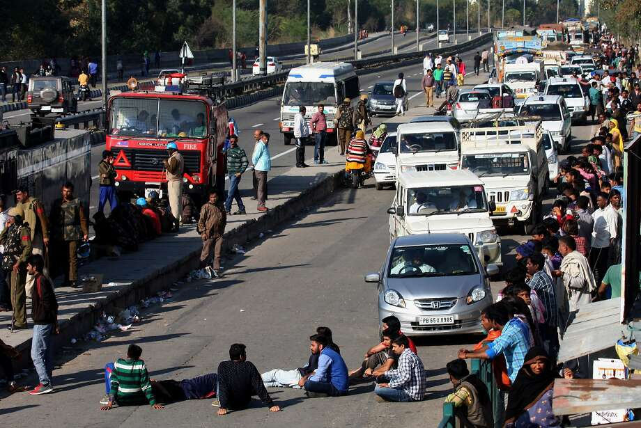 """Members of the Jat community block a highway in Panchkula in Haryana state. The protesters are seeking status as a """"backward class"""" to make them eligible for government jobs. Photo: Strdel, AFP / Getty Images"""