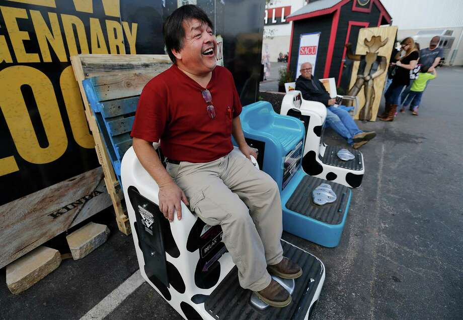 Antonio Lira of Kyle enjoys his respite on the Footsie Wootsie massage chair while visiting the 2016 San Antonio Stock Show & Rodeo with his family on Saturday, Feb. 13, 2016. Lira said a bad knee sometimes bothers him during long walks and the chair, for 25 cents, gives him pain relief. People of all ages tried the chairs to relax their feet or to merely have some inexpensive fun while venturing throughout the vast stock show grounds. Photo: Kin Man Hui /San Antonio Express-News / ©2016 San Antonio Express-News