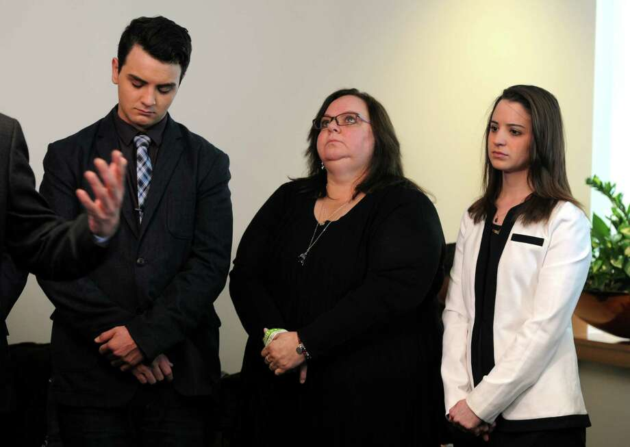 Carlos, Donna and Jillian Soto join other Sandy Hook families suing a gunmaker for providing the AR-15-type Bushmaster at a news conference at Koskoff, Koskoff & Bieder in Bridgeport on Monday. A state Superior Court judge will decide whether the lawsuit will be dismissed or progress to a jury trial. Photo: Cathy Zuraw / Hearst Connecticut Media / Connecticut Post