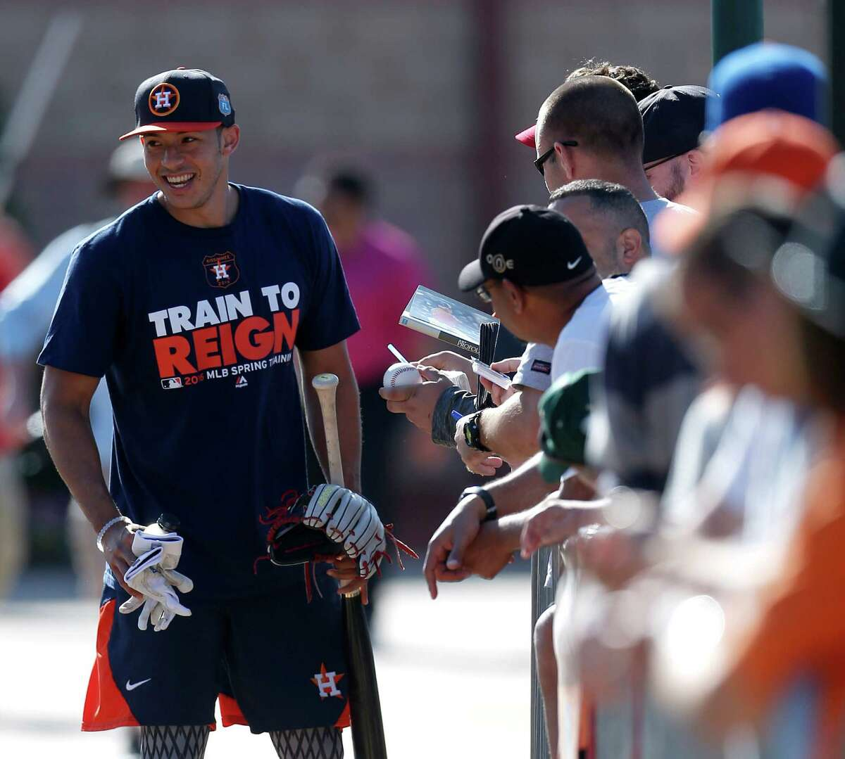 Houston Astros SS Carlos Correa stops to sign autographs during spring training in Kissimmee, Florida, Monday, Feb. 22, 2016.