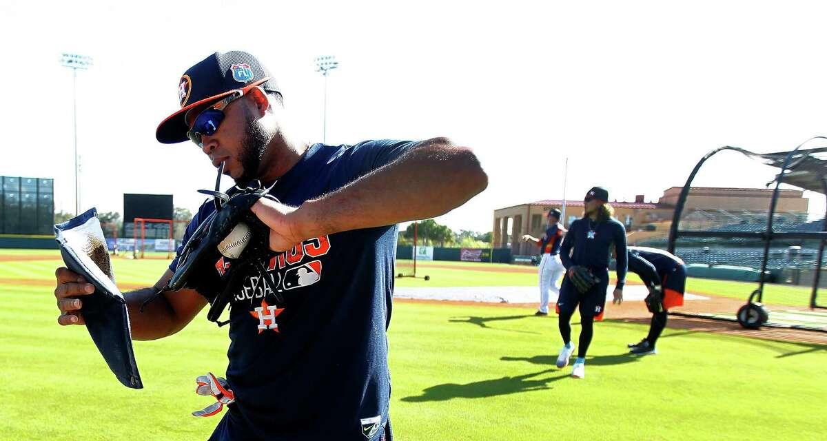 Houston Astros infielder Luis Valbuena wipes his glove down during spring training in Kissimmee, Florida, Monday, Feb. 22, 2016.
