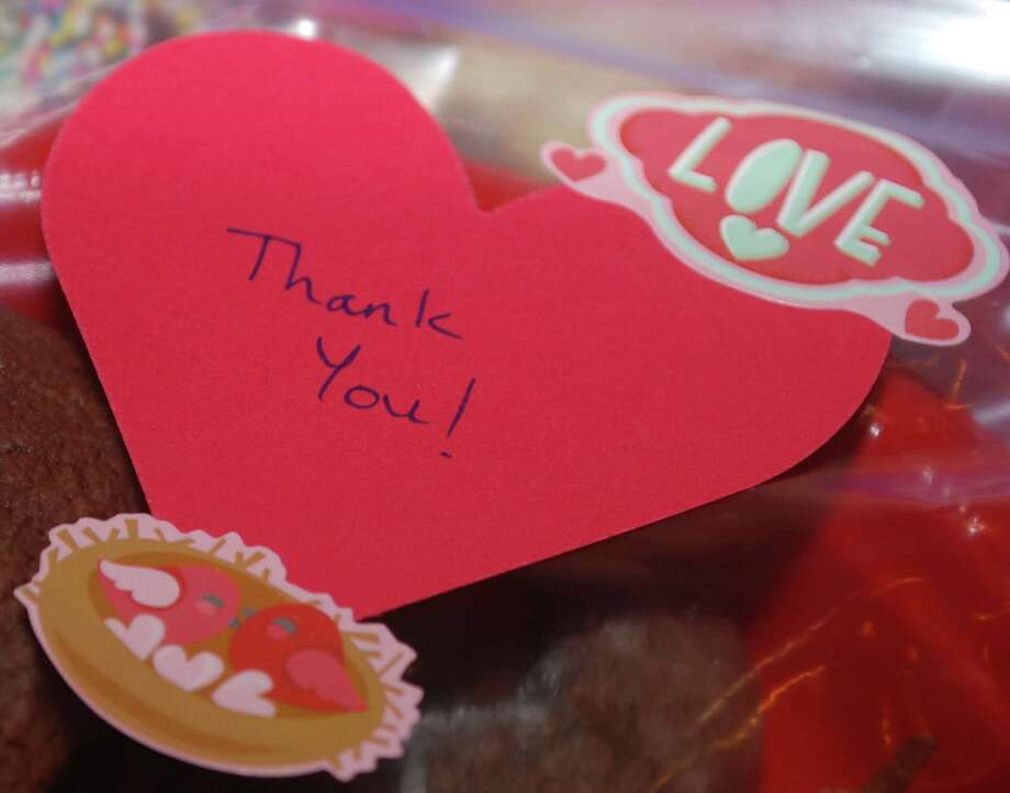 """Spectrum/A homemade """"thank you"""" message adorns the to-go plates of chocolate treats for patrons of the 21st annual Chocolate Fest, a fundraiser for the Kent Center School Scholarship Fund held Feb. 10, 2016, at Kent Center School. Photo: Deborah Rose / Deborah Rose / The News-Times"""