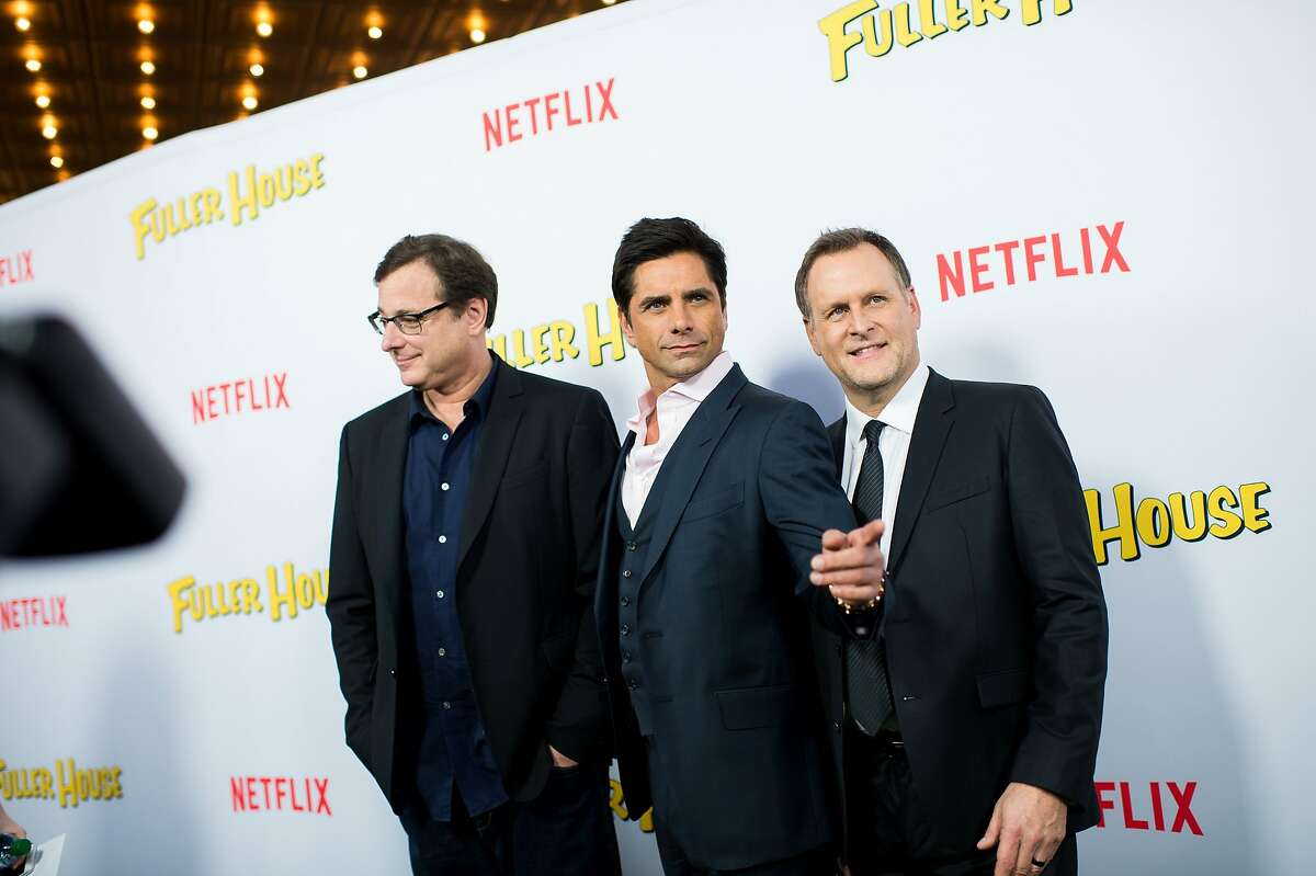 (L-R) Actors Bob Saget, John Stamos, and Dave Coulier attend the premiere of Netflix's 'Fuller House' at Pacific Theatres at The Grove on February 16, 2016 in Los Angeles.
