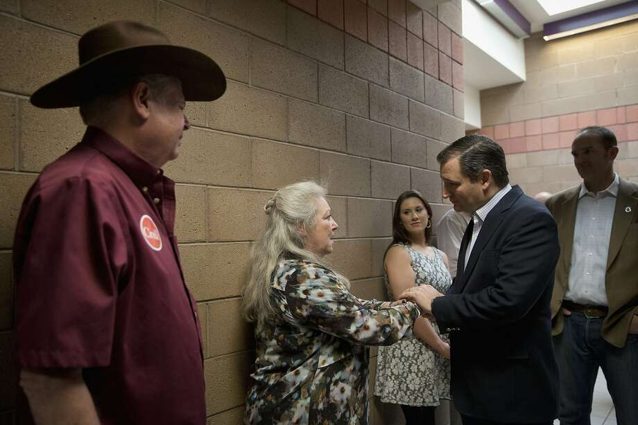 GOP candidate Ted Cruz (right) meets with supporters in Las Vegas. Cruz fired his campaign spokesman for tweeting a false story about rival Marco Rubio. Photo: Jae C. Hong, Associated Press