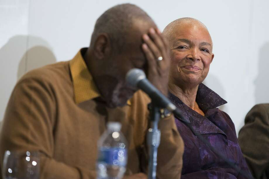 FILE - In this Nov. 6, 2014 file photo, Camille Cosby, right, looks on as Bill Cosby speaks during a news conference about the upcoming exhibit, Conversations: African and African-American Artworks in Dialogue at the Smithsonian's National Museum of African Art, in Washington. After amassing a private collection of African-American Art over four decades, Cosby and his wife Camille plan to showcase their holdings for the first time in an exhibition planned at the Smithsonian Institution. Sexual assault allegations that recently resurfaced against Bill Cosby first became public in 2005 when a former employee of his alma mater, Temple University, claimed he had drugged and abused her a year earlier at his suburban Philadelphia home. (AP Photo/Evan Vucci, File) Photo: Evan Vucci, AP