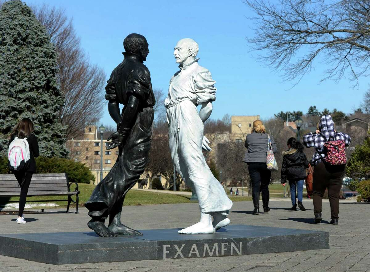 """The two-part sculpture of St. Ignatius is entitled """"Examen"""" at the Egan Chapel of St. Ignatius Loyola plaza on Fairfield University's campus in Fairfield, Conn. on Monday, Feb. 22, 2016. One of the prime components of St. Ignatius'' Spiritual Exercises, the Examen is St. Ignatius' cornerstone prayer for discerning God's presence in daily life."""