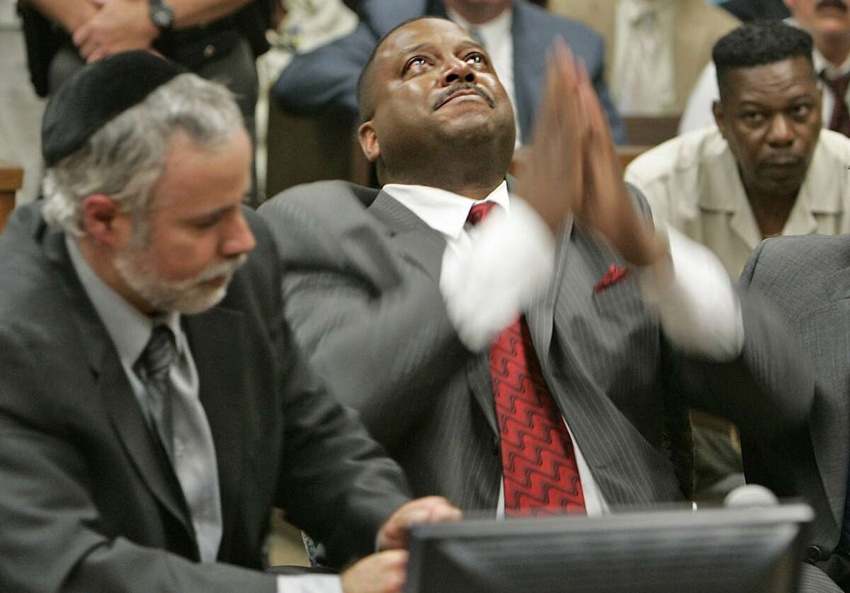 """Ex-deputy Ivory John Webb Jr. is found not guilty as he cries and hugs his lawyers after hearing the verdict in a San Bernardino, Calif., court room in a June 2007 file image. (Karen Tapiaâ€""""Andersen/Los Angeles Times/TNS)"""