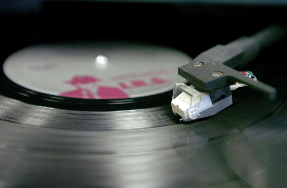A return visit to vinyl is not regression or nostalgia, it is a willful act of slowing down. Of relearning the pleasure of savoring, the self-control of concentrating, the challenge of looking at something old with new eyes. Photo: Bob Chwedyk /Associated Press / Daily Herald