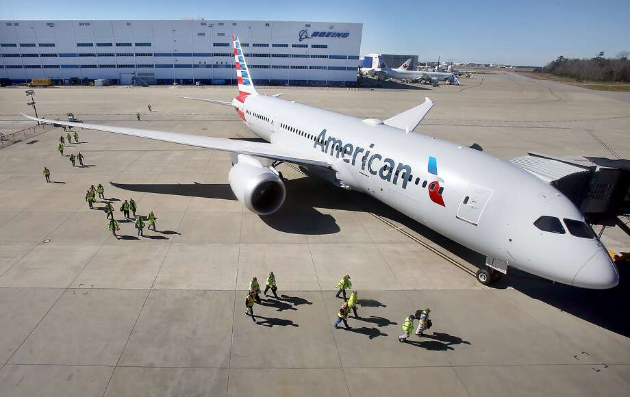 Boeing of South Carolina workers make their way past the 100th 787 Dreamliner to be delivered from  the North Charleston, S.C., facility, Tuesday, Feb. 16, 2016. The plane was delivered to American Airlines. Photo: Brad Nettles, Associated Press