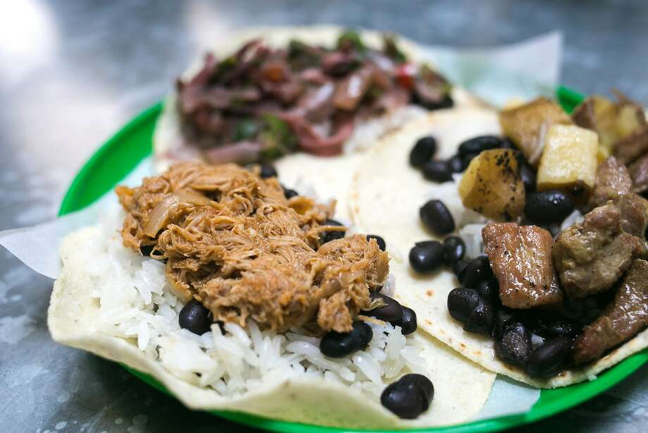 Three of the tacos offered at Tacos Cala on Friday February 19, 2016: Puerco en Naranja, Pollo en Chipolte, and Calamar a la Veracruzana Photo: Jen Fedrizzi, Special To The Chronicle