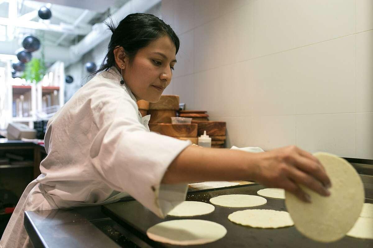 Margarita Mejia makes fresh tortillas for tacos at Tacos Cala.