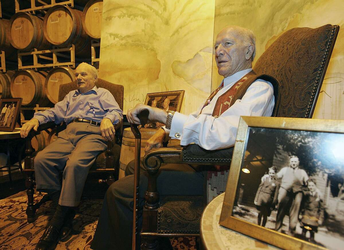 In this 2005 file photo, Peter Mondavi, left, and his brother Robert Mondavi, right, sit together during a Napa Valley wine auction event in St. Helena, Calif.
