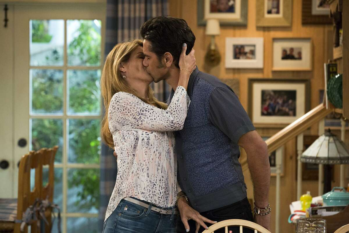 This image released by Netflix shows Lori Loughlin, left, and John Stamos in a scene from,