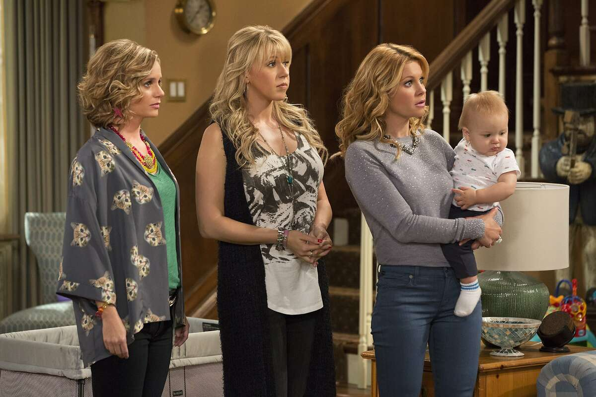 This image released by Netflix shows, from left, Andrea Barber, Jodie Sweetin, and Candace Cameron Bure in a scene from,