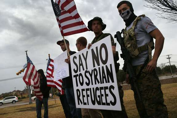 RICHARDSON, TX - DECEMBER 12: Armed protesters from the so-called Bureau of American-Islamic Relations (BAIR), take part in a demonstration in front of a mosque on December 12, 2015 in Richardson, Texas. About two dozen members of the group protested in front of the Islamic Association of North Texas mosque, as counter-protesters demonstrated across the street. The Dallas area had become a focal point for so-called Islamophobia, even before the Islamic extremist-inspired December 2 mass shooting in San Bernadino, California. (Photo by John Moore/Getty Images) *** BESTPIX ***