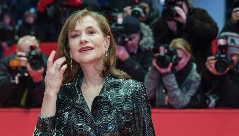 """French actress Isabelle Huppert poses for photographers on the red carpet for the film """"Things to Come,"""" one of the prize-winners at this year's Berline Film Festival. Photo: JOHN MACDOUGALL /Getty Images / AFP or licensors"""