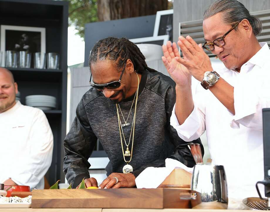 "Snoop Dogg and ""Iron Chef"" Masaharu Morimoto roll sushi on last year's culinary stage. Photo: Courtesy BottleRock Napa Valley"