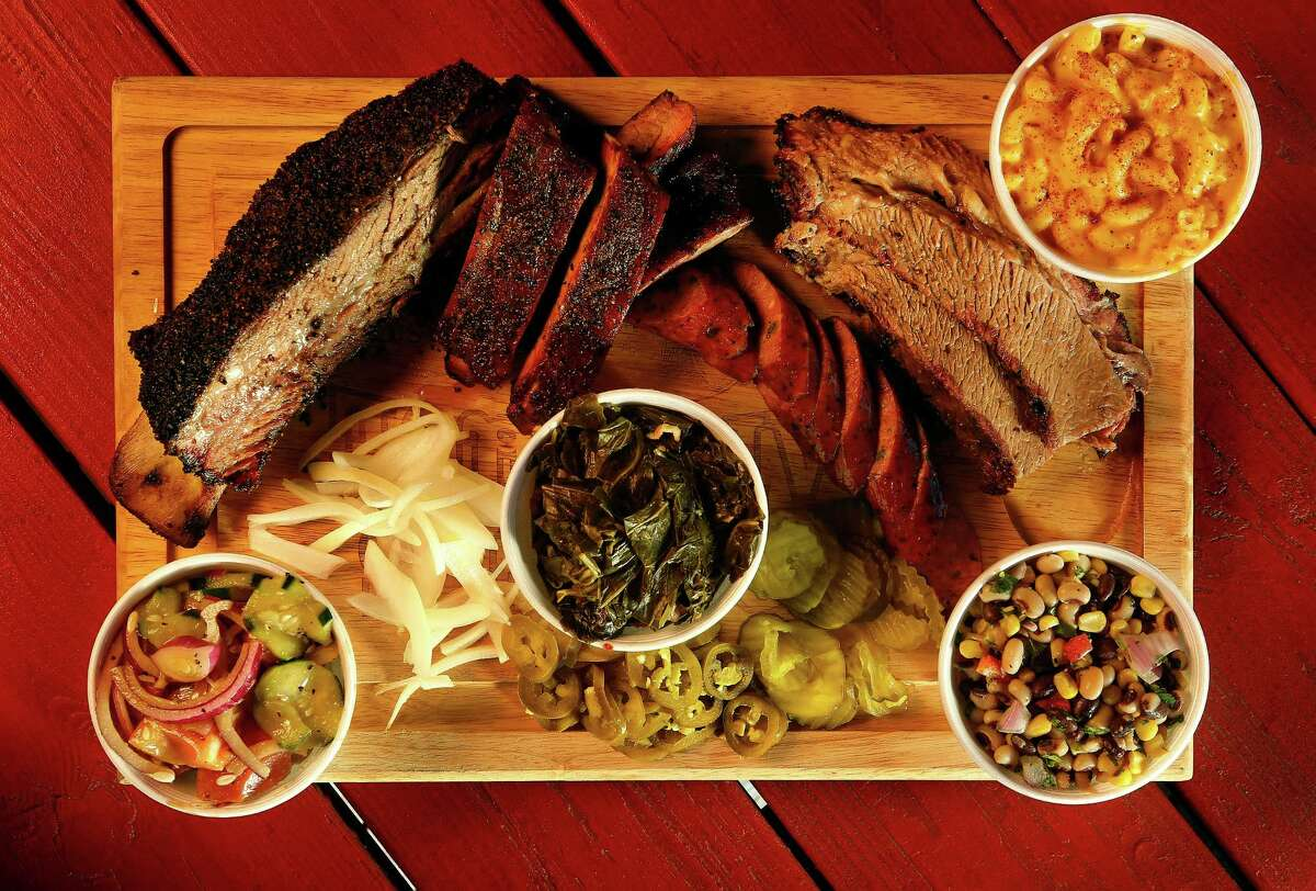 The sides refuse to take a backseat to the meat at Roegels Barbecue Co. on Voss Road, Wednesday, Feb. 17, 2016, in Houston. Tomatoes and cucumbers, collard greens, Texas caviar and mac and cheese surround the ribs, sausage and brisket. ( Mark Mulligan / Houston Chronicle )