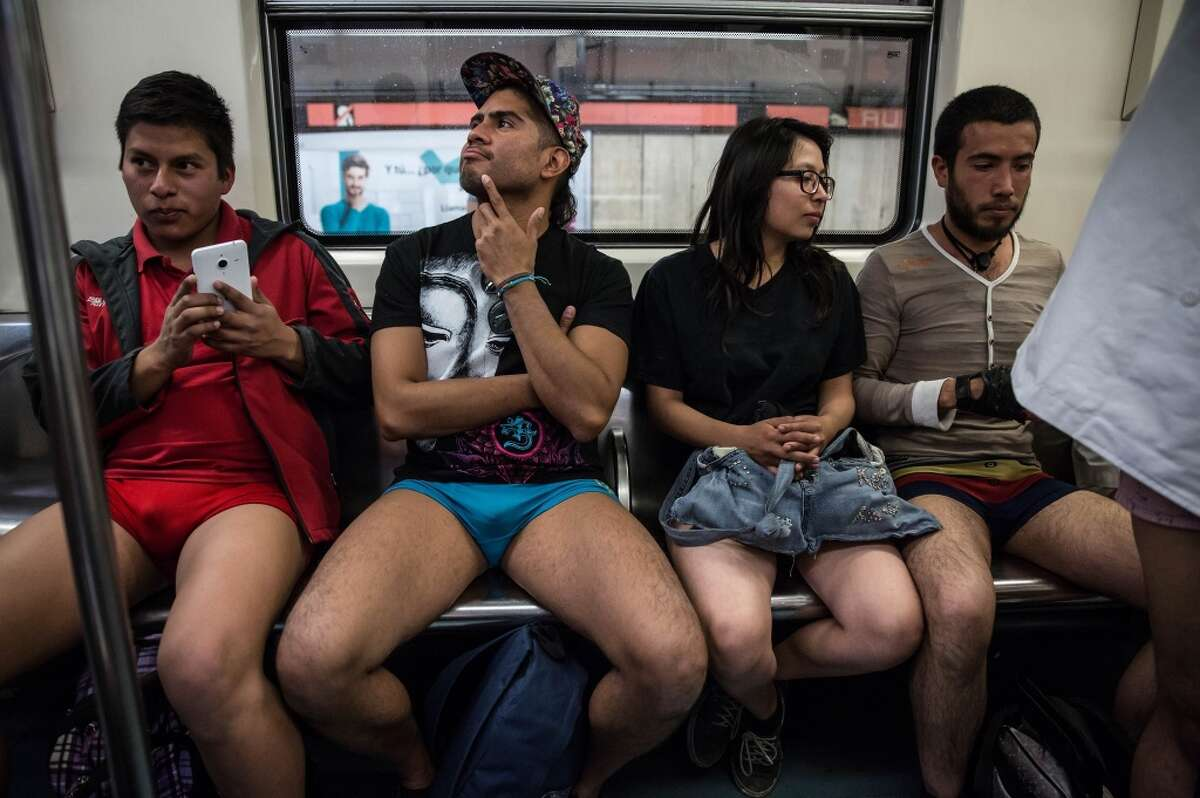 People take part in the event called No Pants Subway Ride 2016 at the Mexico City Subway in Mexico City, Mexico on February 21, 2016.