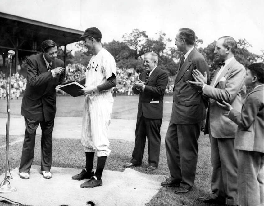 Baseball legend Babe Ruth presents his papers to Yale University in 1948. They are received by Yale baseball team captain, George Bush.