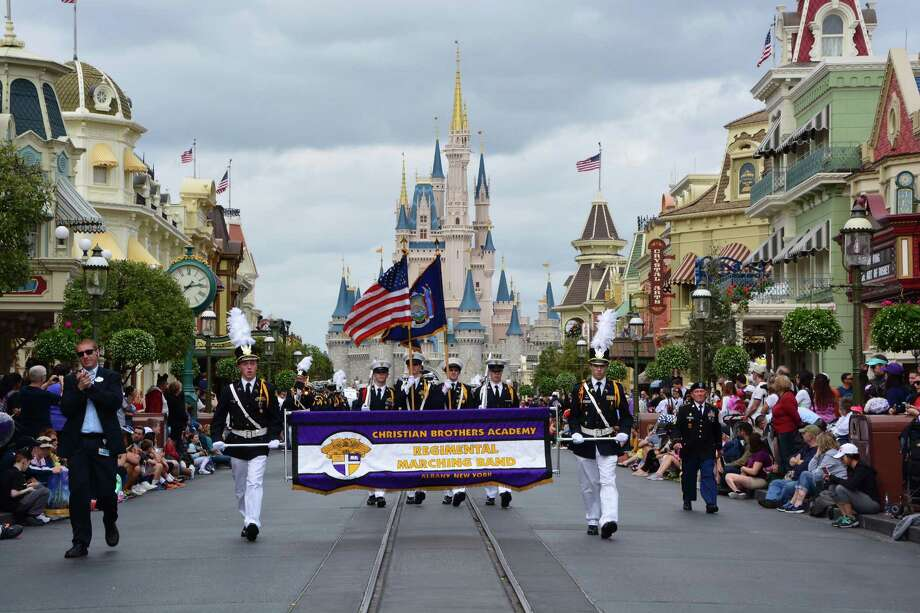 Christian Brothers Academy band students entertained Walt Disney World Resort guests with their performance on Feb. 15 at Magic Kingdom Park in Florida. Under the direction of band director Sarah Waite, the Regimental Marching Band & Drill Team put on a military-inspired pre-parade show, marching past Cinderella Castle while playing songs and cadences. This was the group's ninth visit to Walt Disney World Resort. Photo: Walt Disney World / DISNEY/HANDOUT