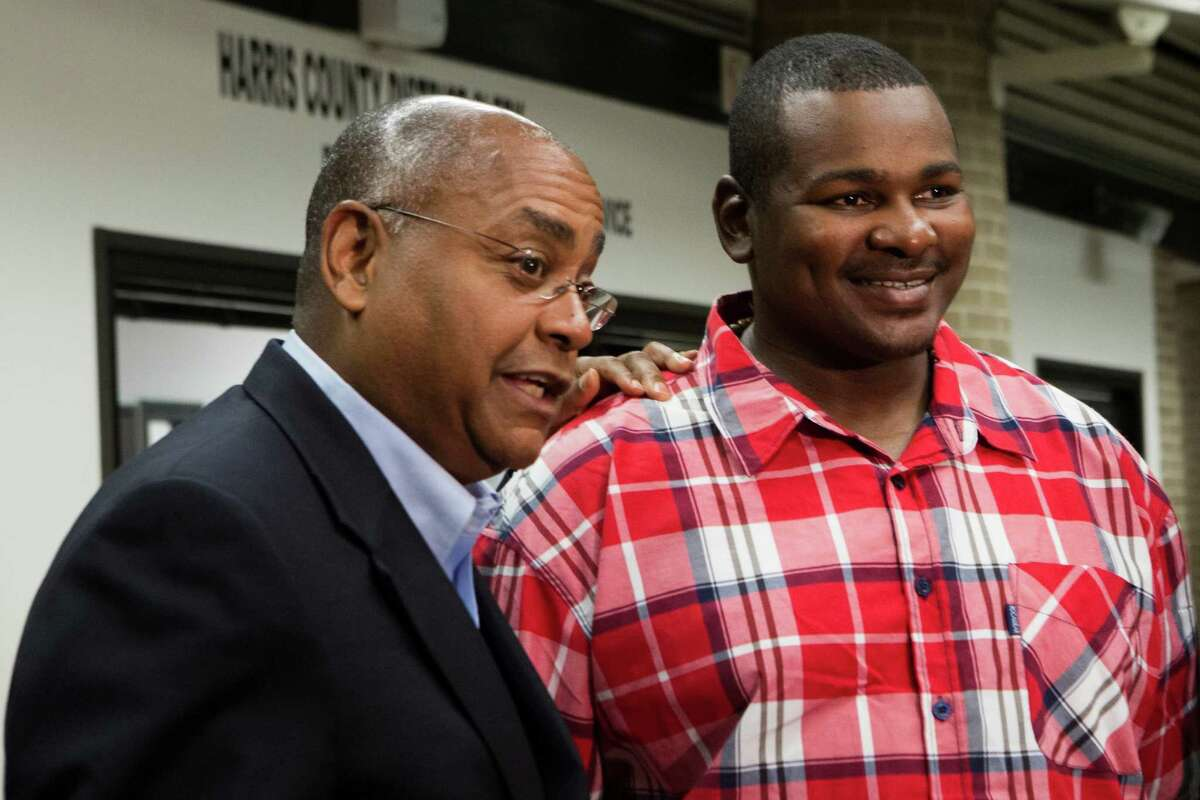 At a news conference Monday, Alfred Dewayne Brown, right, 33, listens to State Sen. Rodney Ellis talk about the request to compensate Brown with state funds for his wrongful conviction.
