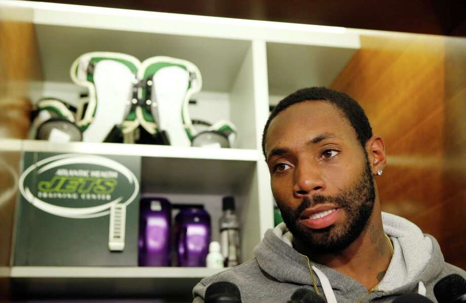 FILE - In this Dec. 30, 2015, file photo, New York Jets cornerback Antonio Cromartie speaks to reporters in front of his locker at the team's NFL football training facility in Florham Park, N.J.  The New York Jets have released cornerback Antonio Cromartie, a cost-cutting move that will save the team $8 million in salary cap space. The decision Monday, Feb. 22, 2016,  marks the second time in three years that the Jets have cut Cromartie, who was re-signed last offseason after a year in Arizona. (AP Photo/Kathy Willens, File) ORG XMIT: NY162 Photo: Kathy Willens / AP