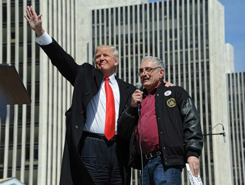 Donald Trump, left, stands with Carl Paladino, businessman and political activist from Buffalo, after he spoke to a crowd of Second Amendment advocates rallying against the NY SAFE Act at the Empire State Plaza Tuesday, April 1, 2014, in Albany, N.Y. State Board of Elections records show Trump has since the beginning of 2000 given more than $640,000 to candidates for local and state office. (Lori Van Buren / Times Union)