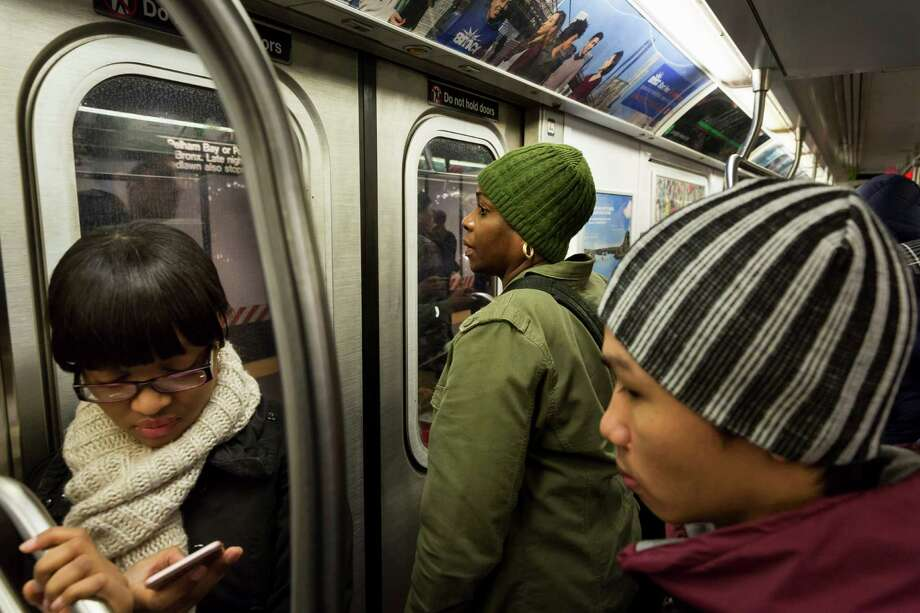 New York City Police Lt. Angela Morris, center, who says its important to have female officers to handle sex crimes, at work as part of team of officers searching for men who use the subway's crowded confines to get too close to women, in New York, Dec. 8, 2015. Social media has given women in the city a tool to fight back, and as the police encourage victims to come forward, they are training more female officers. (Richard Perry/The New York Times) ORG XMIT: XNYT20 Photo: RICHARD PERRY / NYTNS